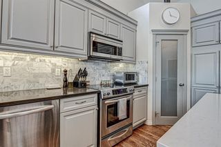 Photo 10: 4 WESTON Place SW in Calgary: West Springs Detached for sale : MLS®# A1027576