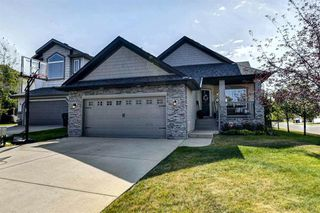 Photo 1: 4 WESTON Place SW in Calgary: West Springs Detached for sale : MLS®# A1027576