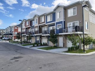 Photo 3: 398 Nolancrest Heights NW in Calgary: Nolan Hill Row/Townhouse for sale : MLS®# A1042890