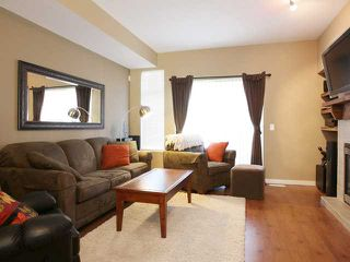 """Photo 2: 48 2000 PANORAMA Drive in Port Moody: Heritage Woods PM Townhouse for sale in """"MOUNTAIN'S EDGE"""" : MLS®# V852937"""