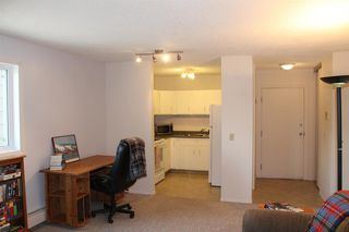 Photo 5: 105 36 GLENBROOK Crescent: Cochrane Apartment for sale : MLS®# A1028403