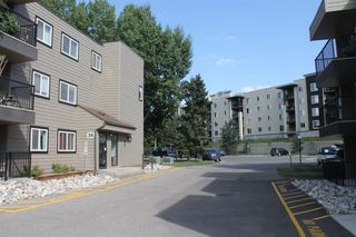 Photo 2: 105 36 GLENBROOK Crescent: Cochrane Apartment for sale : MLS®# A1028403