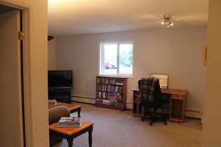 Photo 11: 105 36 GLENBROOK Crescent: Cochrane Apartment for sale : MLS®# A1028403