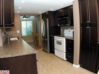 """Photo 2: 104 2533 MARCET Court in Abbotsford: Abbotsford East Townhouse for sale in """"OLD YALE HEIGHTS"""" : MLS®# F1022838"""