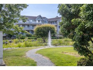 "Photo 18: 202 5568 201A Street in Langley: Langley City Condo for sale in ""Michaud Gardens"" : MLS®# R2470791"