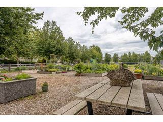 "Photo 19: 202 5568 201A Street in Langley: Langley City Condo for sale in ""Michaud Gardens"" : MLS®# R2470791"