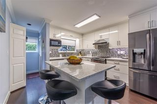 "Photo 8: 101 7881 120A Street in Surrey: West Newton Townhouse for sale in ""BRIARWOOD GARDEN"" : MLS®# R2528444"