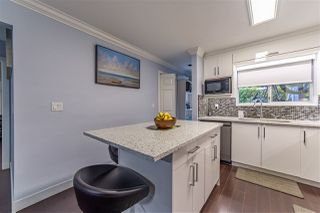 "Photo 9: 101 7881 120A Street in Surrey: West Newton Townhouse for sale in ""BRIARWOOD GARDEN"" : MLS®# R2528444"