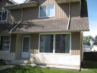 Photo 1: 18030 95A Avenue in Edmonton: Zone 20 House Half Duplex for sale : MLS®# E4168178