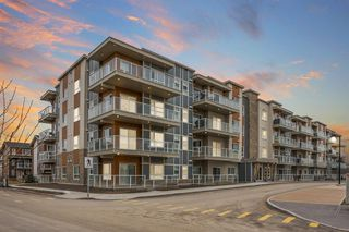 Main Photo: 404 100 Harvest Hills Place NE in Calgary: Harvest Hills Apartment for sale : MLS®# A1053631