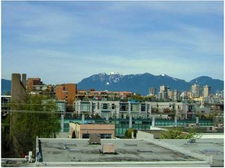 "Photo 1: 401 1635 W 3RD Avenue in Vancouver: False Creek Condo for sale in ""LUMEN"" (Vancouver West)  : MLS®# V850263"