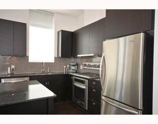 "Photo 3: 708 121 BREW Street in Port Moody: Port Moody Centre Condo for sale in ""ROOM/SUTERBROOK VILLAGE"" : MLS®# V811100"