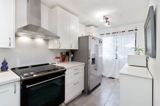 """Photo 2: 222 CARDIFF Way in Port Moody: College Park PM Townhouse for sale in """"EAST HILL"""" : MLS®# R2434858"""