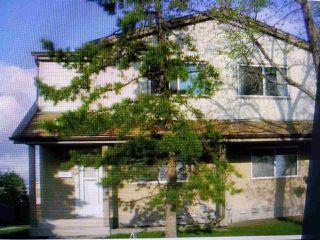 Photo 1: 4711 35 Avenue in Edmonton: Zone 29 Townhouse for sale : MLS®# E4180294