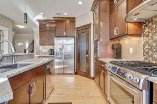 Photo 4: 9339 14 Avenue SW in Calgary: Aspen Woods Detached for sale : MLS®# A1014115