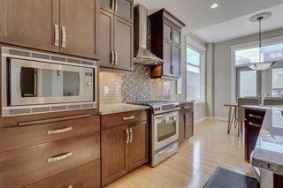 Photo 8: 9339 14 Avenue SW in Calgary: Aspen Woods Detached for sale : MLS®# A1014115