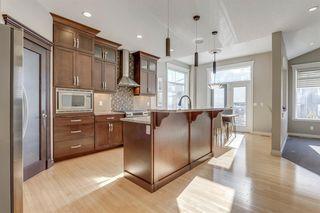 Photo 3: 9339 14 Avenue SW in Calgary: Aspen Woods Detached for sale : MLS®# A1014115