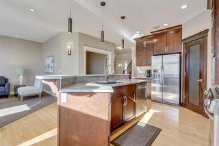 Photo 7: 9339 14 Avenue SW in Calgary: Aspen Woods Detached for sale : MLS®# A1014115