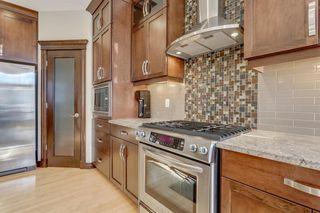 Photo 5: 9339 14 Avenue SW in Calgary: Aspen Woods Detached for sale : MLS®# A1014115