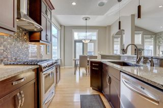 Photo 6: 9339 14 Avenue SW in Calgary: Aspen Woods Detached for sale : MLS®# A1014115