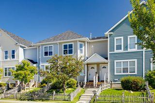 Main Photo: 1104 PRAIRIE SOUND Circle NW: High River Row/Townhouse for sale : MLS®# A1032089