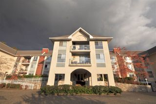 """Photo 1: 310 19835 64 Avenue in Langley: Willoughby Heights Condo for sale in """"Willowbrook Gate"""" : MLS®# R2512847"""