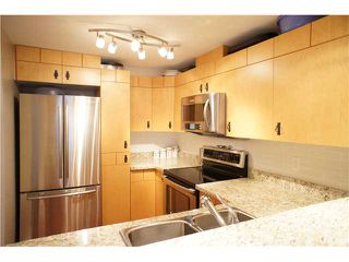 """Photo 1: 55 7488 SOUTHWYNDE Avenue in Burnaby: South Slope Townhouse for sale in """"LEDGESTONE 1"""" (Burnaby South)  : MLS®# V864166"""