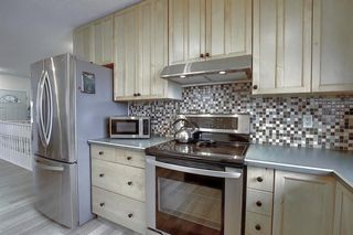Photo 7: 15 Glenpatrick Place: Cochrane Detached for sale : MLS®# A1051475