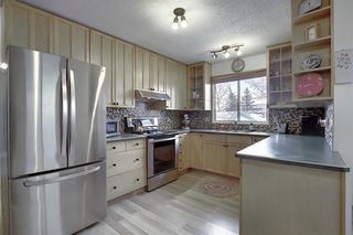 Photo 4: 15 Glenpatrick Place: Cochrane Detached for sale : MLS®# A1051475