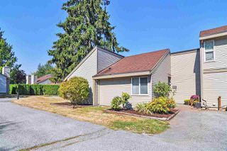 """Main Photo: 6022 E GREENSIDE Drive in Surrey: Cloverdale BC Townhouse for sale in """"Greenside Estates"""" (Cloverdale)  : MLS®# R2496333"""