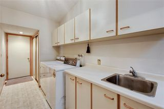 Photo 17: 52 WOODMEADOW Close SW in Calgary: Woodlands Semi Detached for sale : MLS®# C4259772