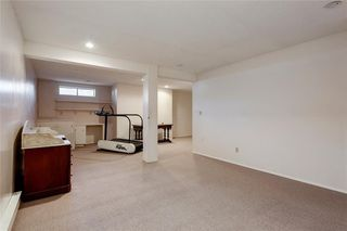 Photo 18: 52 WOODMEADOW Close SW in Calgary: Woodlands Semi Detached for sale : MLS®# C4259772