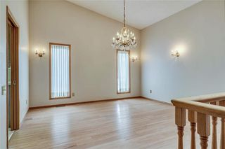 Photo 5: 52 WOODMEADOW Close SW in Calgary: Woodlands Semi Detached for sale : MLS®# C4259772