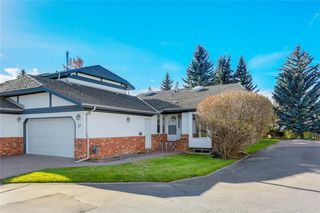 Photo 1: 52 WOODMEADOW Close SW in Calgary: Woodlands Semi Detached for sale : MLS®# C4259772