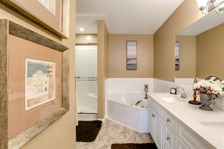 Photo 27: 308 PROMINENCE Heights SW in Calgary: Patterson Semi Detached for sale : MLS®# A1037279