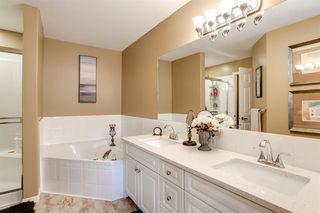 Photo 26: 308 PROMINENCE Heights SW in Calgary: Patterson Semi Detached for sale : MLS®# A1037279