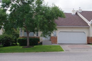 Photo 2: 308 PROMINENCE Heights SW in Calgary: Patterson Semi Detached for sale : MLS®# A1037279
