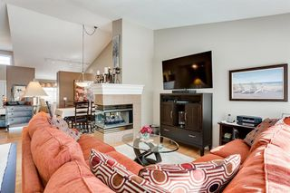 Photo 6: 308 PROMINENCE Heights SW in Calgary: Patterson Semi Detached for sale : MLS®# A1037279