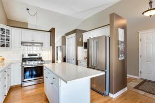 Photo 18: 308 PROMINENCE Heights SW in Calgary: Patterson Semi Detached for sale : MLS®# A1037279