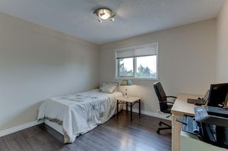 Photo 19: 128 Douglas Woods Terrace SE in Calgary: Douglasdale/Glen Detached for sale : MLS®# A1045408