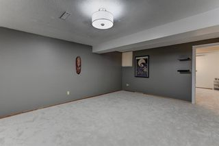 Photo 16: 128 Douglas Woods Terrace SE in Calgary: Douglasdale/Glen Detached for sale : MLS®# A1045408