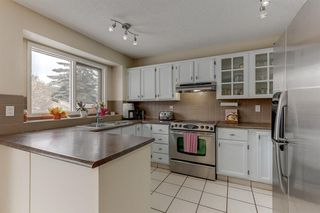 Photo 7: 128 Douglas Woods Terrace SE in Calgary: Douglasdale/Glen Detached for sale : MLS®# A1045408