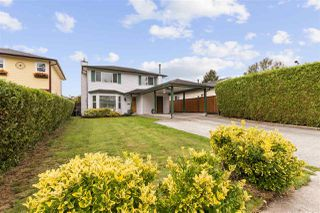 Photo 1: 19512 115A Avenue in Pitt Meadows: South Meadows House for sale : MLS®# R2509347
