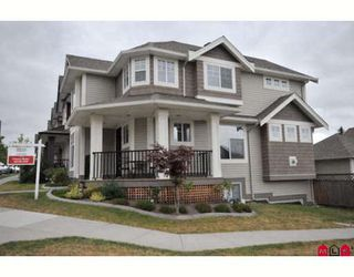 """Photo 1: 16408 60TH Avenue in Surrey: Cloverdale BC House for sale in """"BIRDSONGS"""" (Cloverdale)  : MLS®# F2915229"""