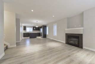Photo 2: 12207 103 Street in Edmonton: Zone 08 House Half Duplex for sale : MLS®# E4179047