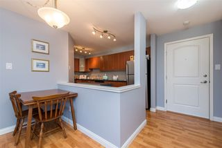 "Photo 3: 303 3063 IMMEL Street in Abbotsford: Central Abbotsford Condo for sale in ""Clayburn Ridge"" : MLS®# R2421613"