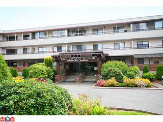 "Photo 1: 106 20420 54TH Avenue in Langley: Langley City Condo for sale in ""Ridgewood Manor"" : MLS®# F1022963"