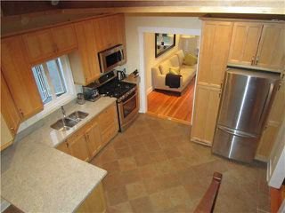 """Photo 6: 4462 JOHN Street in Vancouver: Main House for sale in """"MAIN ST"""" (Vancouver East)  : MLS®# V846144"""