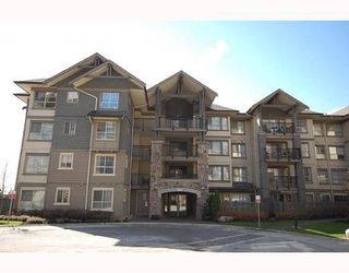 "Photo 1: 204 2958 WHISPER Way in Coquitlam: Westwood Plateau Condo for sale in ""SUMMERLIN"" : MLS®# V786045"