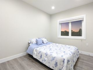Photo 4: 4989 MOSS Street in Vancouver: Collingwood VE 1/2 Duplex for sale (Vancouver East)  : MLS®# R2525974
